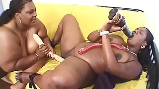 BBW ebony MILF fucks another BBW with a dildo at home
