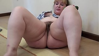 A fat girl with a hairy pussy masturbates with a cucumber